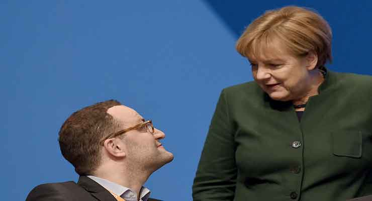 Pictured: German Chancellor Angela Merkel (right) and Jens Spahn (left), a top contender for succeeding Merkel as leader of the CDU party. (Photo by Volker Hartmann/Getty Images)