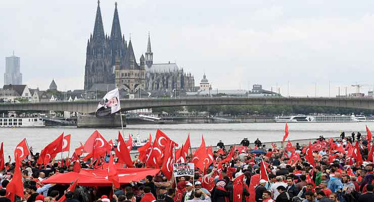 Pictured: Thousands of supporters of Turkish President Recep Tayyip Erdogan rally, waving Turkish flags, in Cologne, Germany, July 31, 2016. (Photo by Sascha Steinbach/Getty Images)