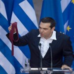 Tsipras marks agreement on Greek debt with red tie