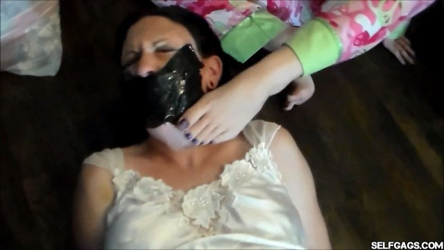 Duct tape gagged mom face rubbed with daughter's stinky feet selfgags