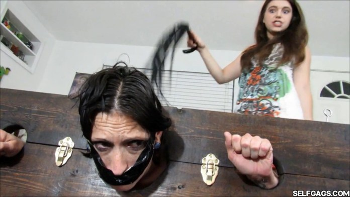 Evil daughter whipping her gagged mom