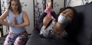 Asian damsel tape gagged and hogtied by her milf client (photo: selfgags.com)