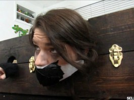 Daughter locked and tapegagged in stockade for spanking