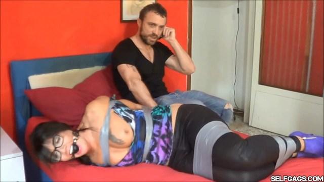 Ball gagged milf in tape bondage selfgags