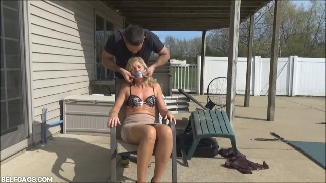 Milf Dakkota tape gagged on a chair selfgags
