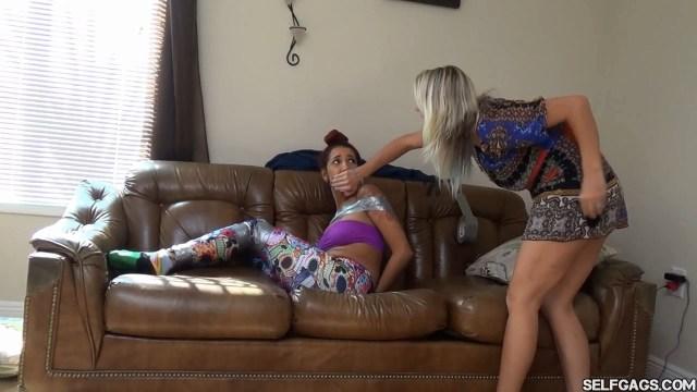 Latina girl handgagged by American milf woman (selfgags)