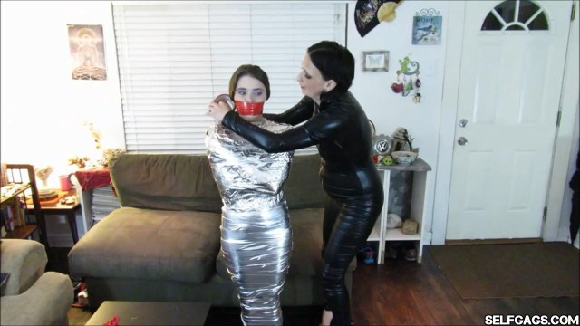 Dominatrix wrapgags young mummified girl selfgags