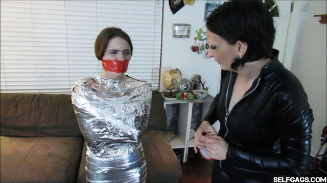 Mummified and tape gagged young girl selfgags