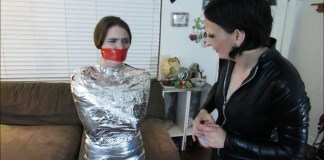 Young girl wraparound tapegagged in tight mummification bondage selfgags