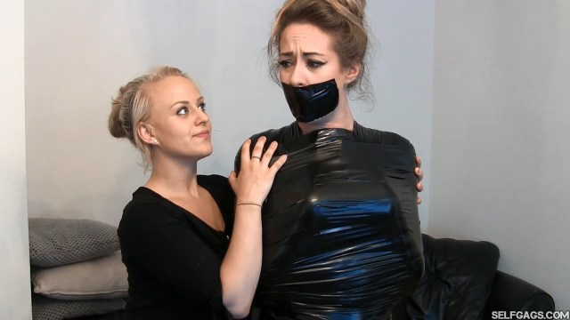 Girl tape gags girl in mummification bondage selfgags