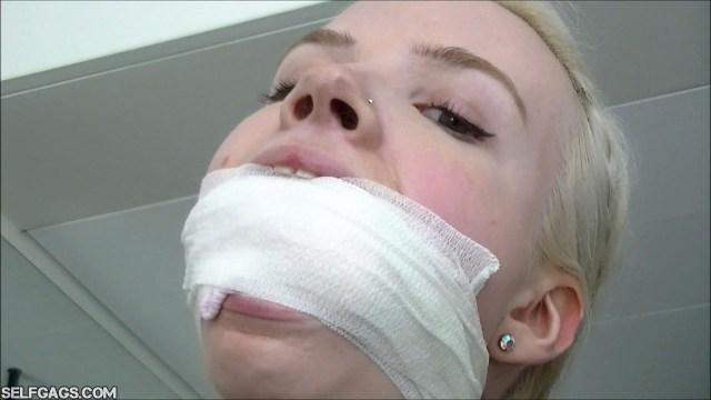Wrap gagged blonde selfgags