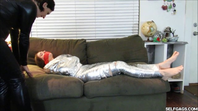 Young girl barefoot in tape mummification bondage selfgags