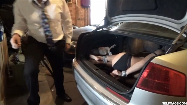 Tape tied real estate lady in car trunk selfgags