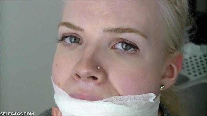 Beautiful blonde girl from Scandinavia gagged selfgags