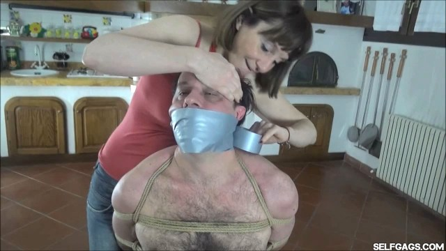 Woman tape gags man tight