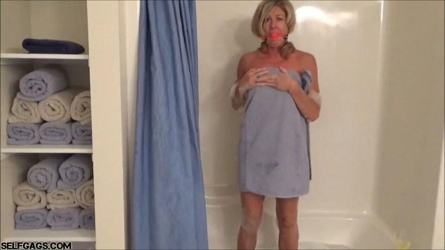 Ball gagged milf Dakkota in towels