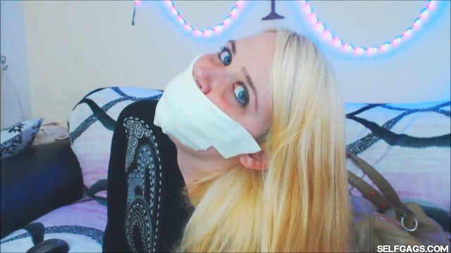 Blonde girl gagged with microfoam tape at selfgags.com