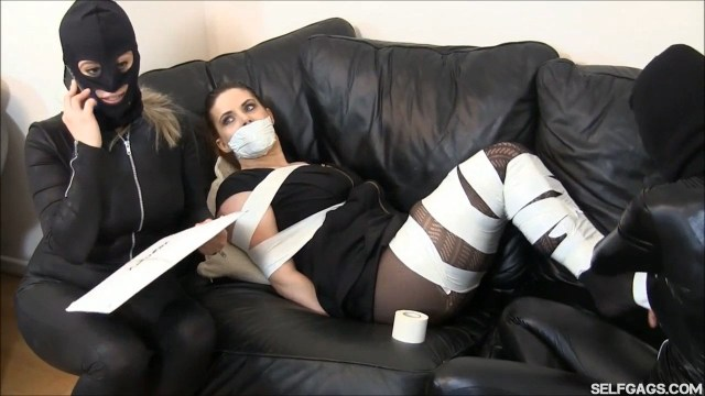 Tape gagged damsel all tied up in tape bondage by catsuit burglars selfgags