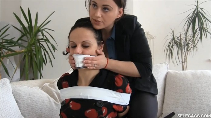 Bondage specialist Carleyelle and her tape gagged female client