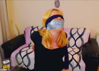 Drunk girl Anne Dville blindfolded and tape gagged
