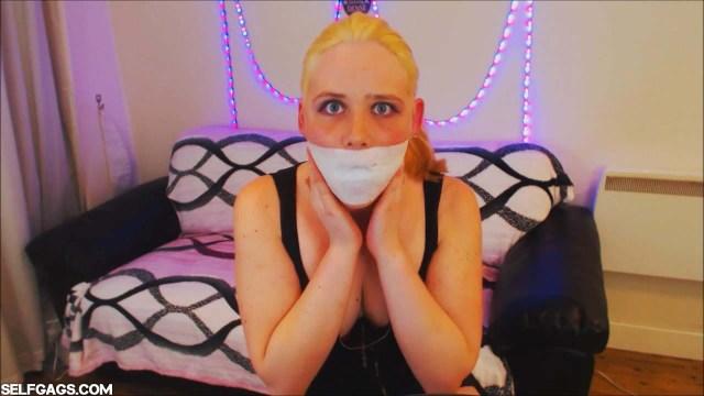 Blonde girl tape gagged