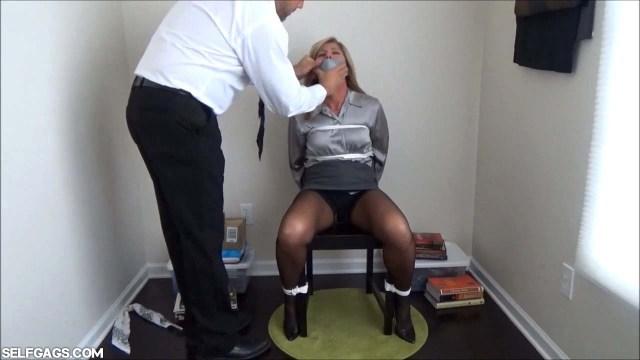 Tape gagged milf teacher tied to a chair