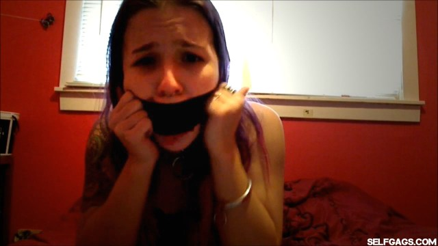 self gagged girl with duct tape