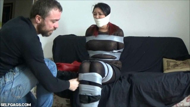 Girl in tape bondage gagged with microfoam tape
