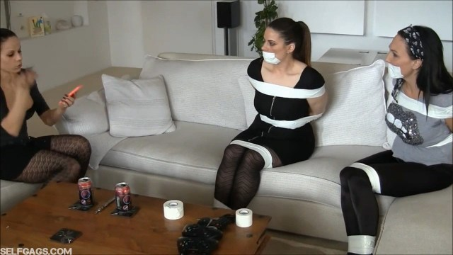 Girls in bondage tied up and tape gagged
