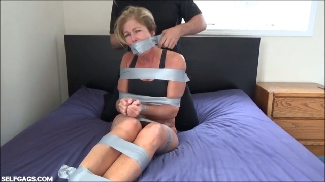 Dakkota Grey tape gagged with tape around the head