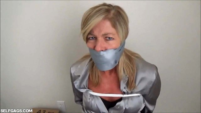 Dakkota Grey tape gagged tight
