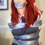 Redheaded girl tied up and gagged by hollyrope