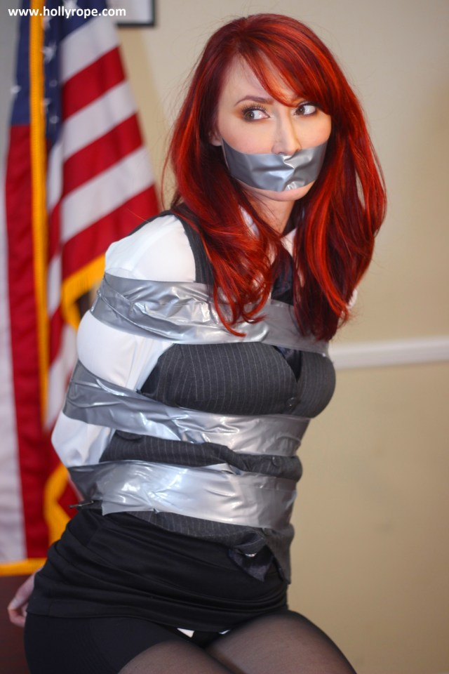 Redhead girl tape gagged and bound with duct tape