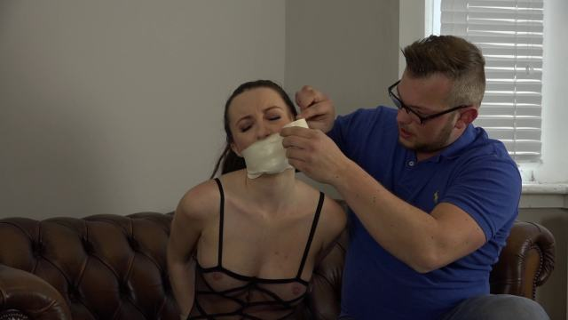 Girl wrapgagged with microfoam tape