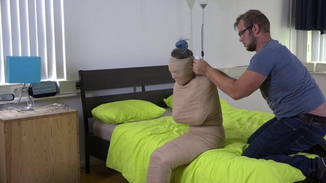 Girl in mummification bondage