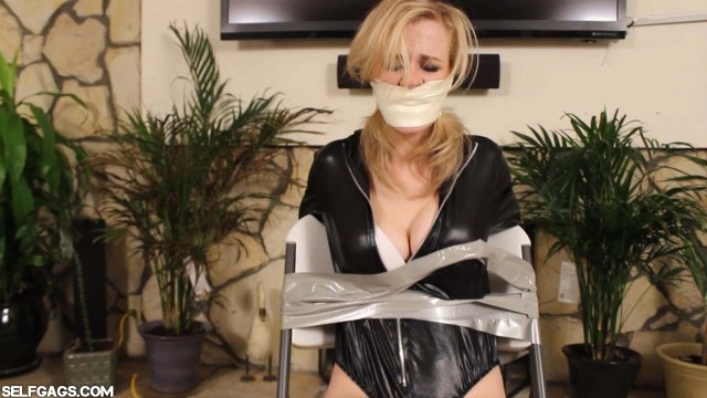 Chair tied blonde gagged with wraparound tapegag