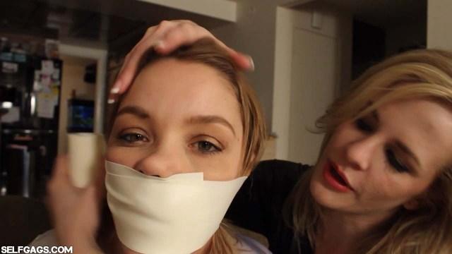 Microfoam tapegag shuts up girl in bondage