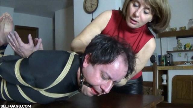 Femdom milf ball gagging hogtied man in bondage