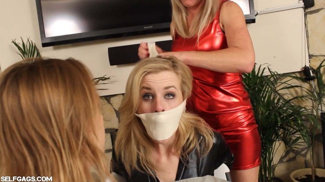 Blonde girl in catsuit gagged with microfoam tape