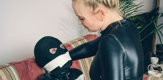 girl in catsuit gagged with microfoam tape
