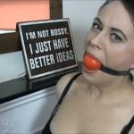 Fetish girl Carleyelle self gagged with big red ballgag