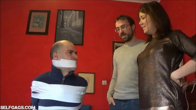Cuckolded guy bound and gagged by girlfriend