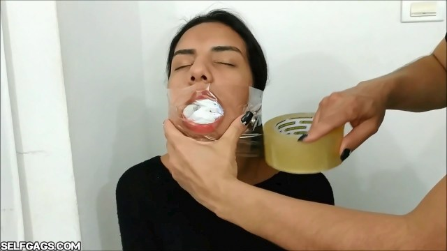 Young latina girl gagged with ten socks taped in her mouth