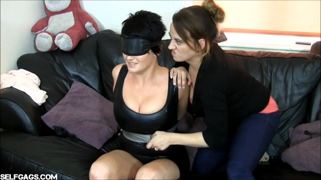 Vengeful wife gets revenge on husband's cheating lover with tight tape bondage