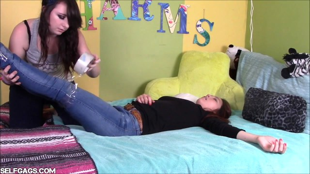 Asian girl tied up and gagged in the bedroom by crazy american