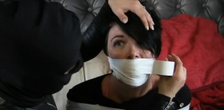 Jet Black bound and gagged by Carleyelle the masked catsuit burglar