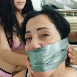 Bound and tape wrap gagged latina milf stuck in duct tape bondage