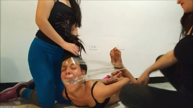 Hogtied girl gets hair pulled while bound and gagged tight