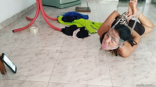 Online latina girl seller tied up and gagged with panties stuffed in her mouth by two women