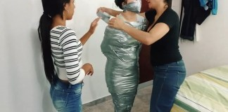 Tape wrap gagged fetish girl trapped in tight silver duct tape mummification bondage
